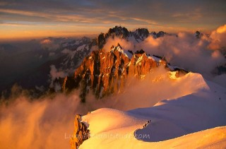 ALPINISTS AT SUNRISE ON THE ARETE MIDI-PLAN, MASSIF DU MONT-BLANC, HAUTE SAVOIE, FRANCE