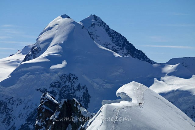 ALPINISTS ON THE RIDGE OF BREITHORN, VALAIS, SWITZERLAND