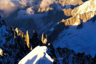 ALPINISTS ON THE ARETE DU MONT-MAUDITAT SUNRISE, MASSIF DU MONT-BLANC, HAUTE SAVOIE, FRANCE
